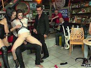 mistress in leather predominates victim in public