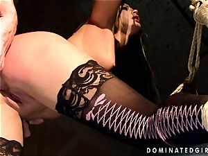 Dark haired gal gets corded and bootie banged by a breaking man-meat