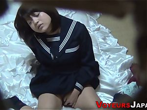 Uniformed chinese babe touches