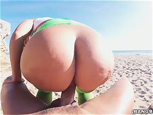 towheaded Fesser boinked on the beach