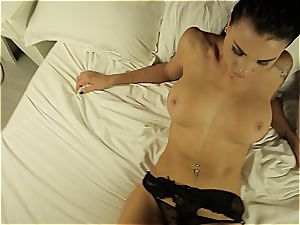 Alluring temptress performing a sizzling dance half naked