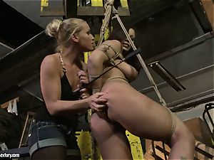 Kathia Nobili smacking the backside of molten nymph with crop