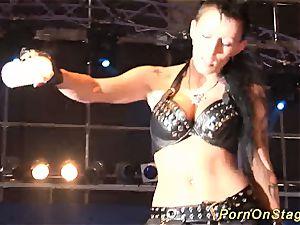 horny fetish needle display on stage