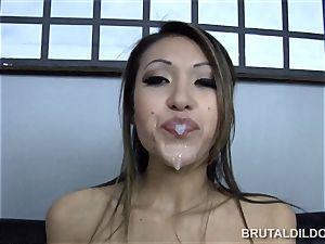 diminutive asian Jayden Lee feeding her puss a massive faux-cock